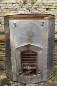 A late 19th century Dutch free standing fireplace in hammered and pierced steel with removeable