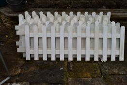 A collection of nine lengths of white painted wooden picket fencing. H.50xW.125cm