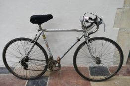 "A 1970's vintage Peugeot ten gear 26"" wheel racing bike. (Has new tyres, missing one gear lever"