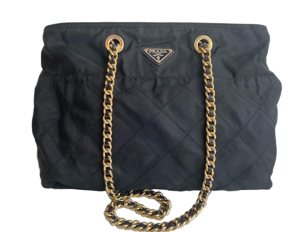 A Prada Tessuto black quilted nylon with gold hardware. W.36cm x H.27cm x D.10cm