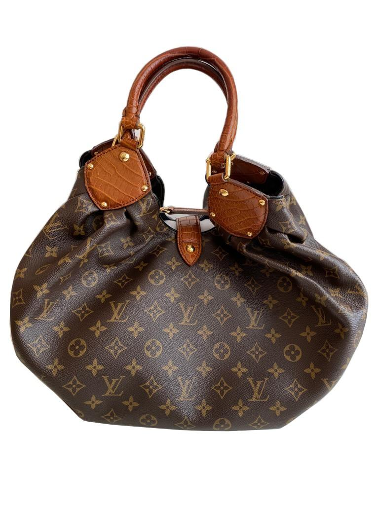 A Louis Vuitton Mahina XL Crocodile Trim Tote in Monogram canvas leather and gold hardware. Includes - Image 5 of 16