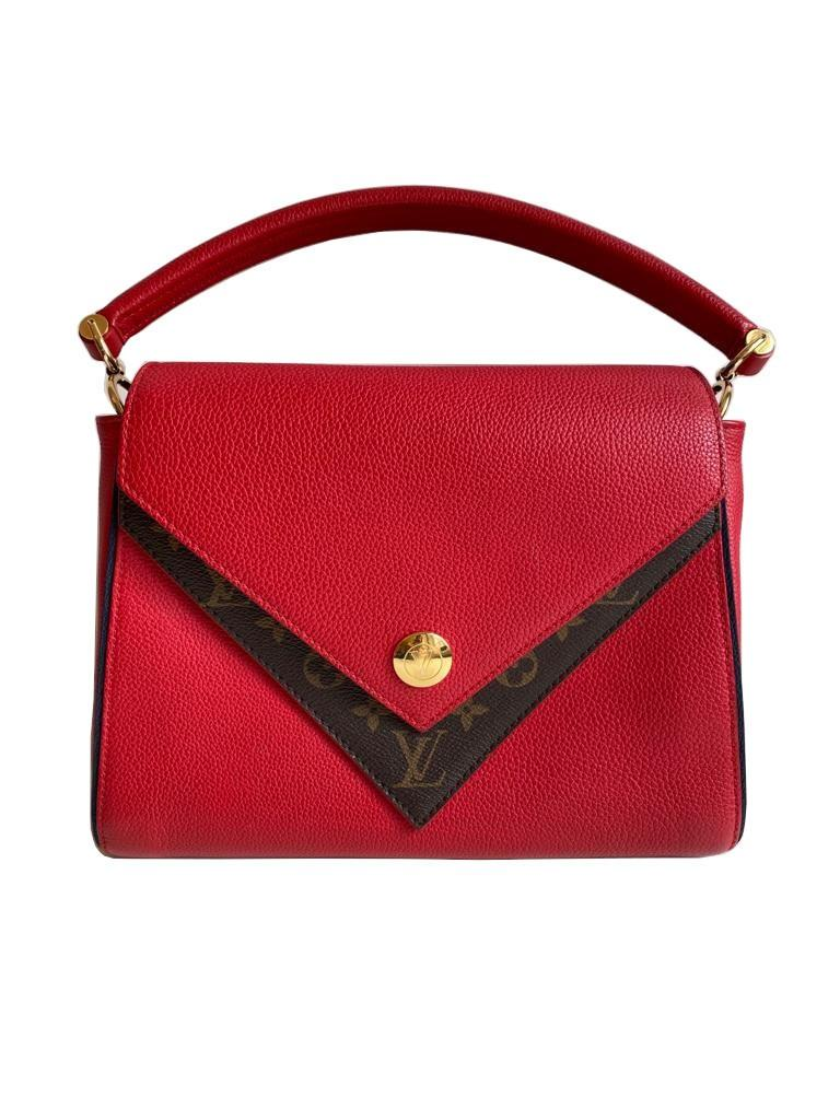 A Louis Vuitton Double V red calf leather and gold hardware. Includes Dustbag, W.28cm x H.20cm x D.