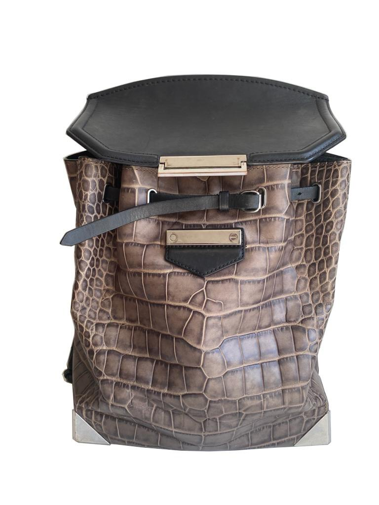 An Alexander Wang Prisma Skeletal Leather embossed Crocodile Backpack with silver hardware. Includes