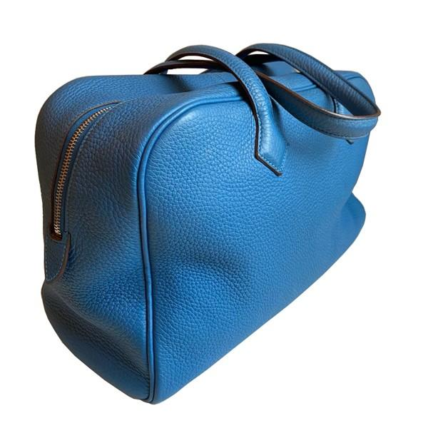 An Hermes Bleu de Galice Victoria II in clemence leather with palladium hardware. Includes