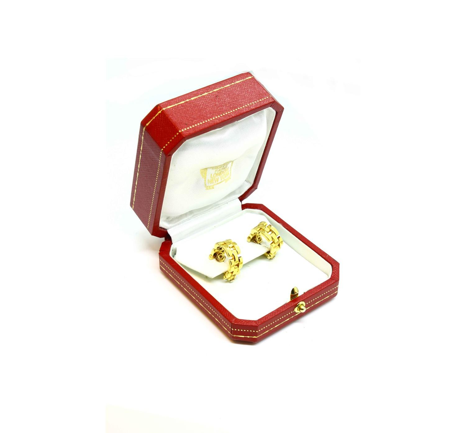 A pair of Cartier Panthere earrings mounted in 18ct gold. English. 1992. Signed and numbered with