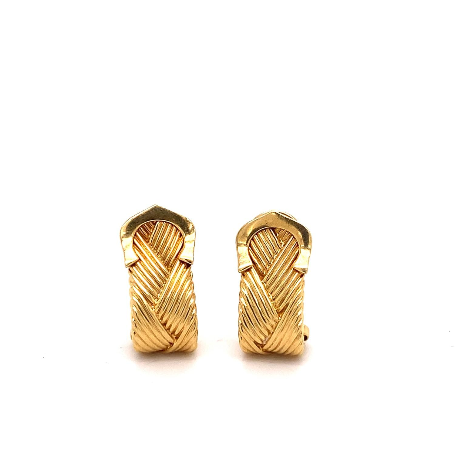A pair of Vintage Cartier crossed C's textured yellow gold ear clips, mounted in 18ct yellow gold. - Image 2 of 2