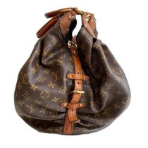 A Louis Vuitton Mahina XL Crocodile Trim Tote in Monogram canvas leather and gold hardware. Includes
