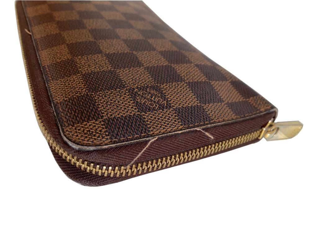 A Louis Vuitton Wallet Ebene in Damier Canvas, with zip. W.21cm - Image 5 of 6