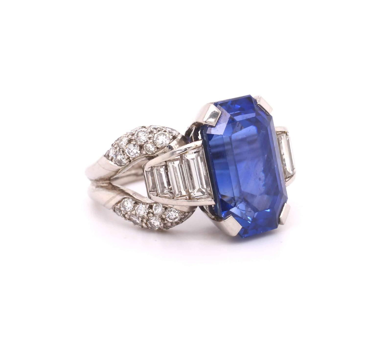A 1950s Vintage sapphire and diamond ring mounted in platinum. French. Circa 1960. The central