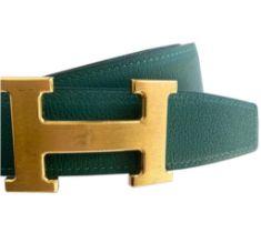 A Hermes Constance Reversible Belt Malachite & Dark Blue Epsom/Swift leather with gold hardware.