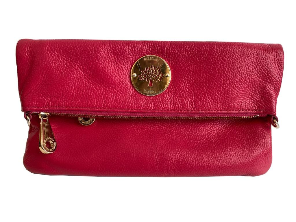 A Mulberry Darwin Convertible Clutch Purse Raspberry in calf leather and silver hardware. W.28cm x
