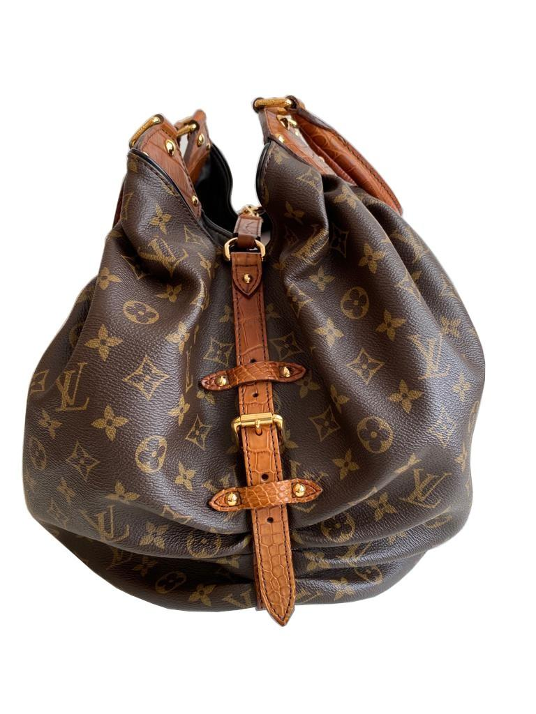 A Louis Vuitton Mahina XL Crocodile Trim Tote in Monogram canvas leather and gold hardware. Includes - Image 13 of 16