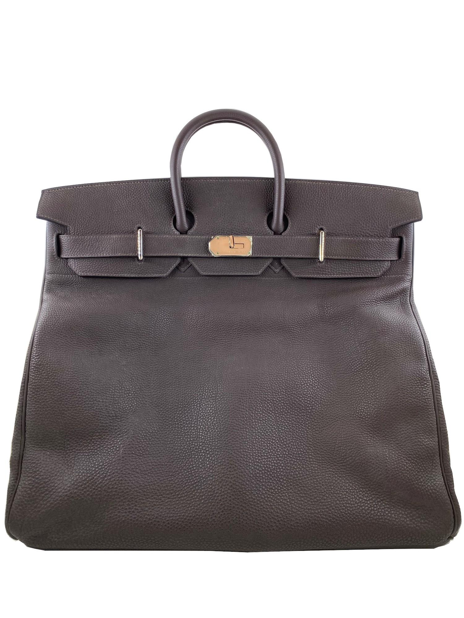 A Brown Hermes Birkin 50cm Haut A Courroies in clemence leather with gold hardware. Includes