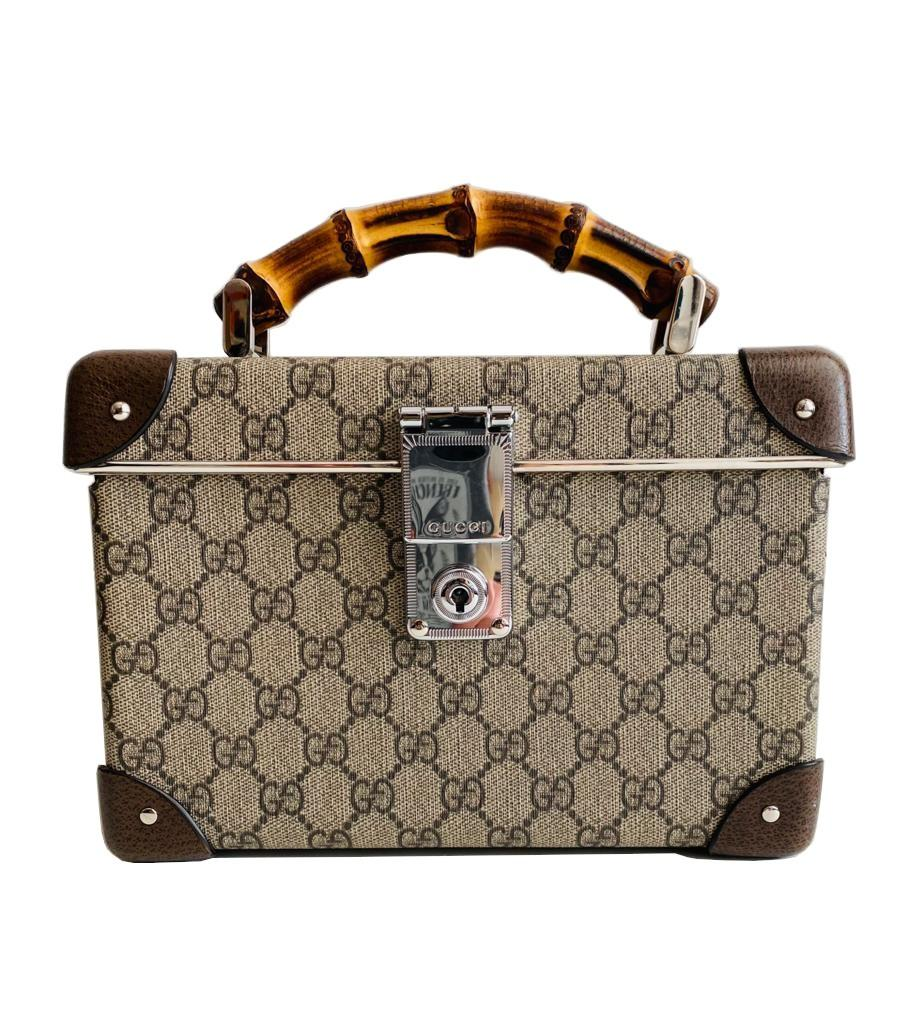 A Gucci Globe Trotter beauty case GG canvas with leather trim and bamboo handle. Includes Strap &
