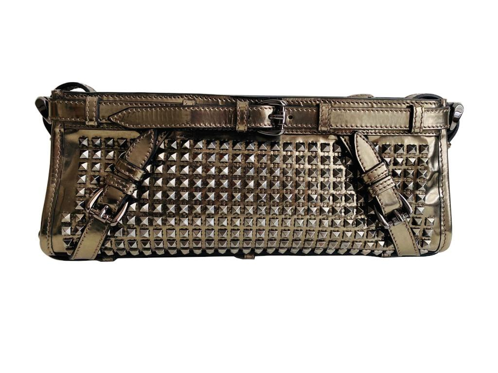 A Burberry metallic Clutch in Pewter Patent leather with silver hardware. Includes Dustbag,