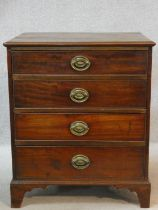 A small Georgian mahogany chest of four drawers on shaped bracket feet. H.73 W.61 D.53cm