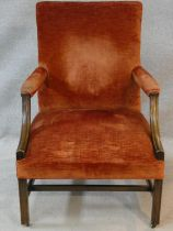 A 19th century mahogany Gainsborough armchair in velour upholstery on moulded square stretched