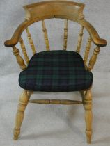 A late 19th century elm captain's armchair with plaid squab cushion. H.85cm