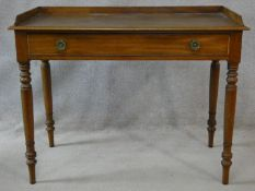 A 19th century mahogany writing table with raised superstructure and single drawer with original