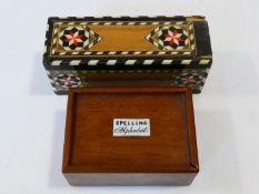 A set of 19th century bone alphabet tiles in a mahogany box with sliding cover inscribed Spelling