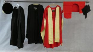 A collection of three various graduation gowns with a cap and a mortarboard, by Ede and Ravenscroft.