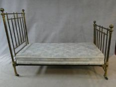 A Victorian brass bedstead made for James Shoolbred, to take a 3 ft mattress.