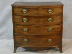 A Regency mahogany bowfronted chest of four long graduating drawers fitted with brass plate