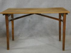 A mid century folding table, makers plaque to the underside. H.70 L.109 W.58cm