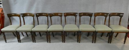 A set of eight William IV mahogany dining chairs with acanthus carving to the backs raised on