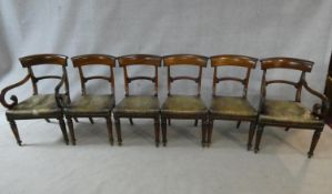 A set of six mid 19th century mahogany bar back dining chairs with leather stuffover seats on