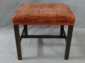 A 19th century mahogany framed stool with stuffover seat on square stretchered supports. H.47 L.52