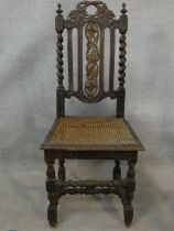 A 19th century oak antique style side chair with carved back on barleytwist stretchered supports.