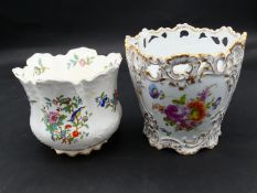 Two antique porcelain hand painted floral design cachepots. One Dresden, with a pierced scrolling