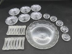 A collection of antique cut crystal items. Including a set of fourteen star cut knife rests, a