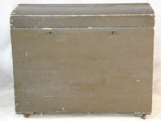 A 19th century domed top travelling trunk on casters. H.88 L.107 W.60cm