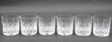 A set of six cut crystal tumblers with abstract design and star cut bases. H.7.5 D.7cm