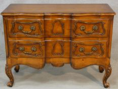 A French provincial chestnut two drawer commode on carved cabriole supports. H.87 W.117 D.48cm