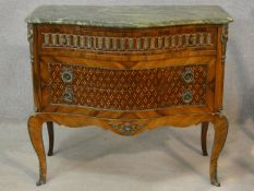 A Louis XV style kingwood and inlaid serpentine fronted marble topped commode with ormolu mounts
