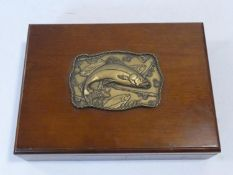 A wooden fishing tackle box with embossed plaque with trout along with an optician's Ultra Lense and