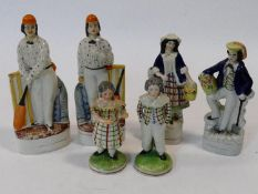 Three pairs of 19th century Staffordshire figures to include, batsman and bowler, flower sellers and