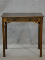 A Georgian mahogany lamp table fitted with frieze drawer on square chamfered supports. H.71 W.71 D.