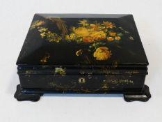 A Victorian lacquered, gilded, painted and mother of pearl inlaid jewellery/stationery box.