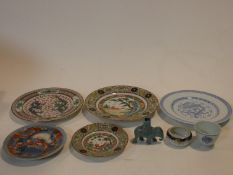A collection of Oriental porcelain items. Including a celadon glaze ceramic elephant spill vase