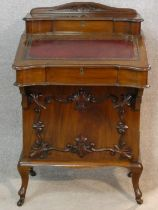 A late 19th century mahogany Davenport with tooled leather writing slope revealing fitted interior