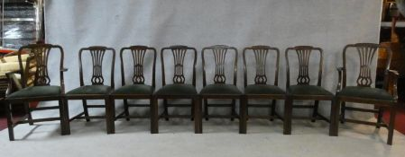 A set of eight late 19th century Georgian style mahogany dining chairs with pierced vase splats