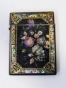 A 19th century paper mache, gilded and mother of pearl inlaid card case, with scrolling gilded and