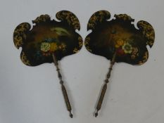 A pair of Victorian hand held face screens with gilt and floral painted decoration with exotic