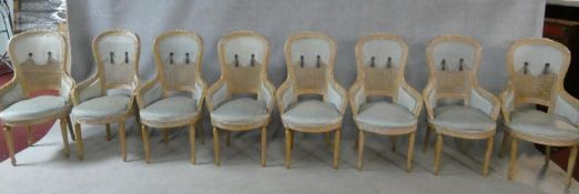 A set of eight Louis XVI style carved beech framed bergere style tub dining chairs in powder blue