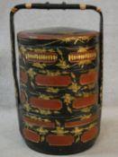 A vintage Chinese four tiered lacquered and gilded marriage basket. Decorated with figures and