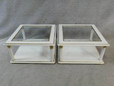 A pair of contemporary white lacquered two tier low tables with inset plate glass tops. H.43 L.80